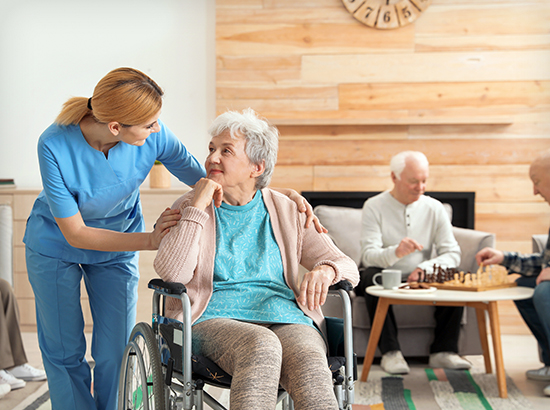 Nurses assisting elderly for long-term care in nursing home